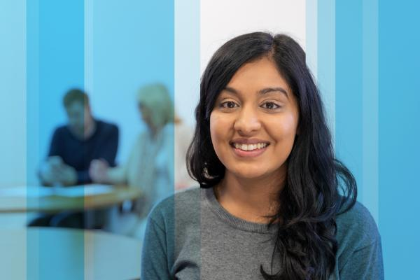 Close up of a woman smiling whilst in HR training