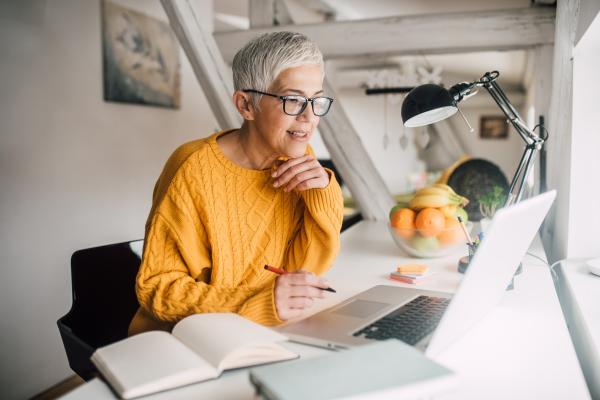 Woman on her laptop, working on developing her emotional intelligence